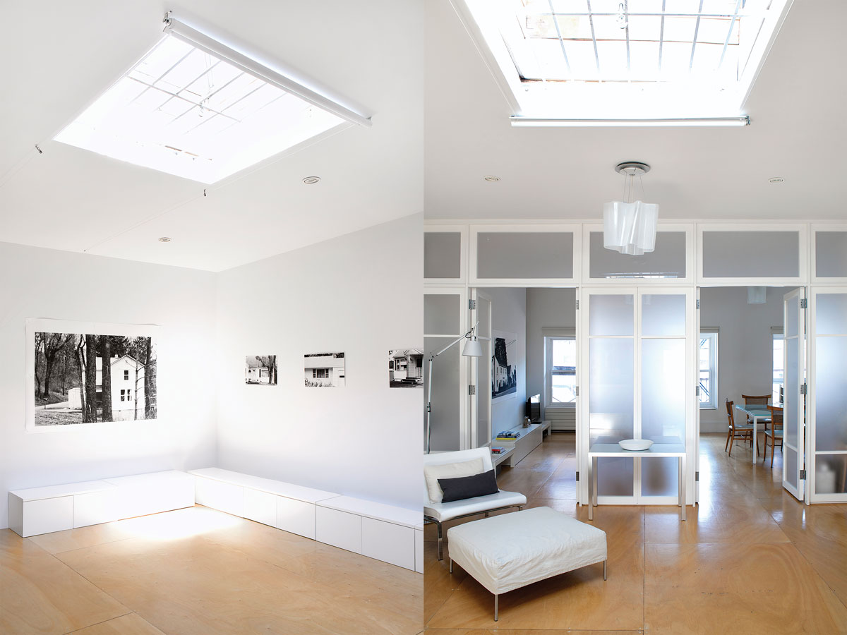 Left: In the gallery area of the apartment, the minimalist white creates a background for the photographer's powerful imagery. Smith designed the low file cabinets that line the room. Right: A translucent glass wall divides the workspace from the living area in the sparsely furnished apartment. Chair and ottoman by Damian Williamson.