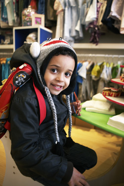 Carlo Finzi-Dubois, 4½, models high-quality, affordable clothing from Stork.