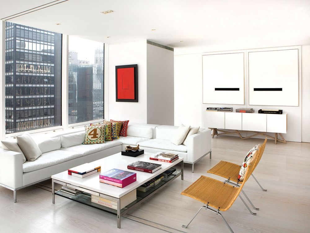 In the media area, Domus Design Collection's DC-5 sofa anchors the conversation area, while two of Poul Kjaerholm's classic PK-22 chairs purchased at auction face the spectacular view. The coffee table is custom. Robert Motherwell's Open Study #9, 1968, adds a vibrant note of red. The seams of the stone floors line up perfectly with the building's structural skeleton, while a delicate reveal below the ceiling line adds an architectural grace note.