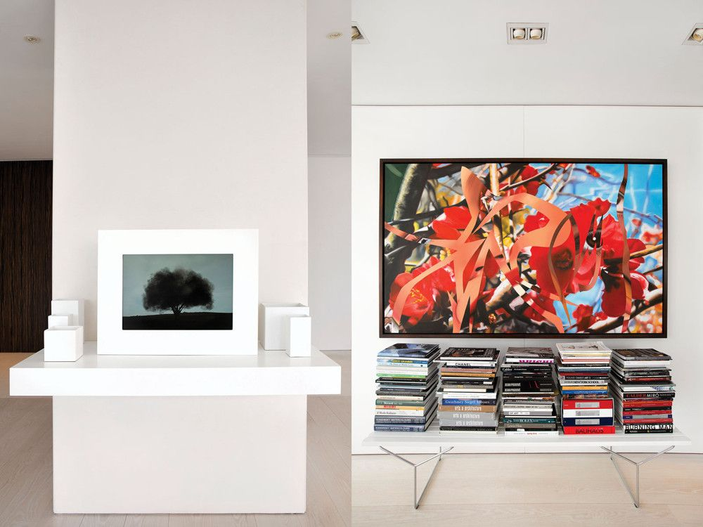 Left: John Gerrard's Smoke Tree, an interactive video sculpture from 2006, animates one of the white walls. Right: James Rosenquist's Untitled, 1991, hangs above a Bertoia bench from Knoll.