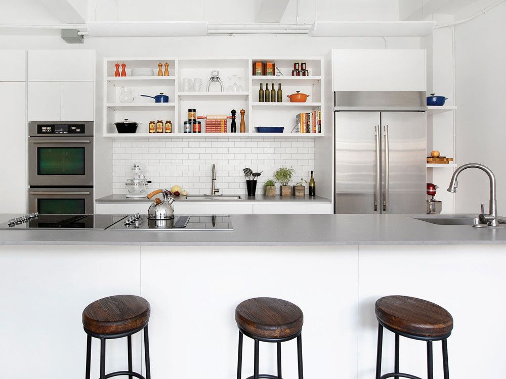 The straightforward, unadorned design of Batali's studio kitchen puts function—and food—first. The vast kitchen island houses two four-burner cooktops. All cabinetry is from Cesar Kitchens; MCKB designer Gregory Hitchcock incorporated the Yara Collection's tall cabinets with 4-cm open shelving system.
