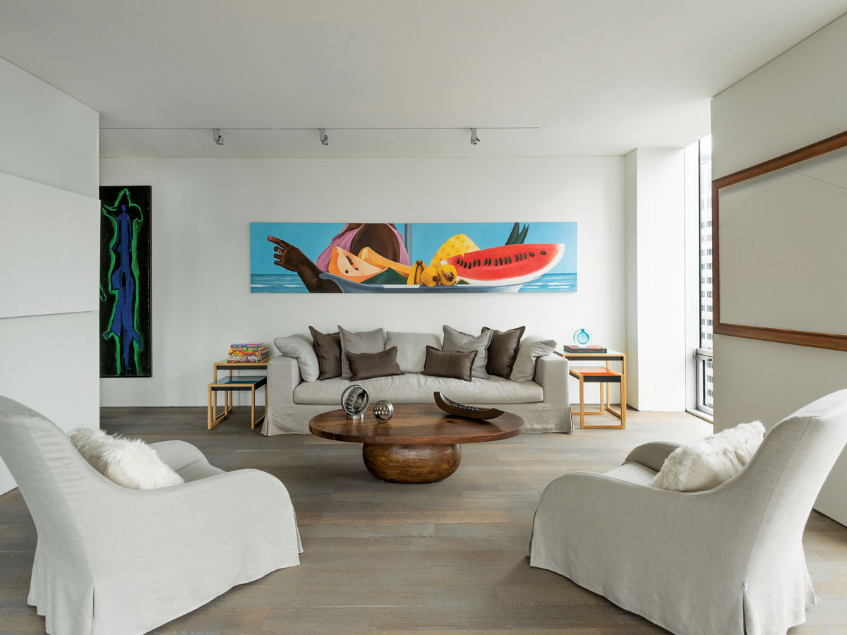 Chairs and a sofa by Molteni surround a handcrafted coffee table by Tucker Robbins. The painting above the sofa is by Ana Mercedes Hoyos. A painting on the right wall is by Rafael Coronel. All the lighting is surface mounted because Mercado didn't want to lower the 9-foot ceilings.