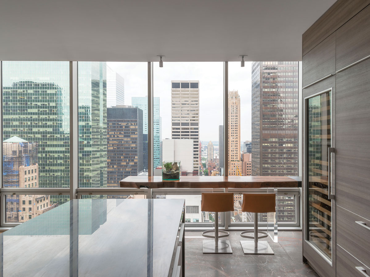 The Poggenpohl kitchen is wide open to the view, which can also be enjoyed from Hudson Furniture's bar table outfitted with stools from Suite NY.