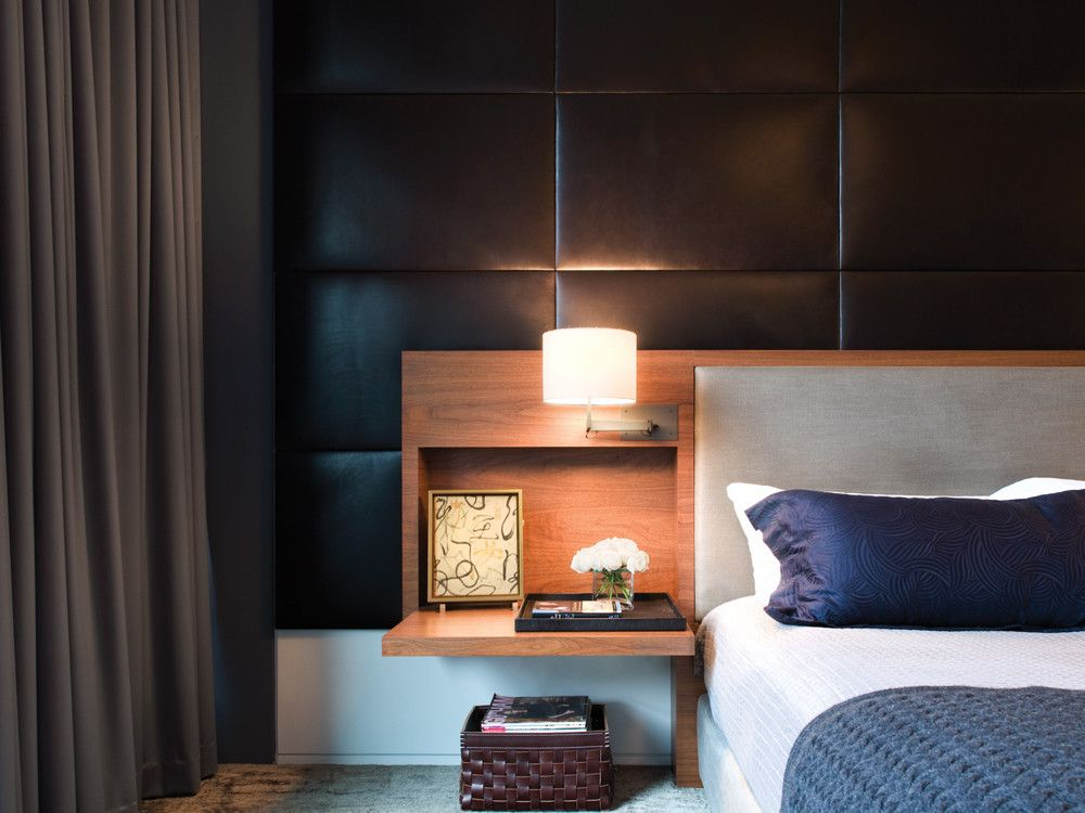 "The bedroom is the only space with wall-to-wall carpet. Says McIntosh: ""The carpet, the wool drapes, the leather wall panels, and the orderliness of the composition completely surround you in a dark, peaceful calm. I'm sure it's a great room to sleep in."""