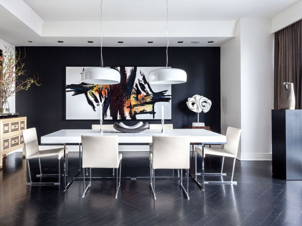 The dining space is a sleek study in black and white punctuated by Chuck Marksberry's huge canvas, Twisted, and Miklós Sebek's mixed media sculpture.