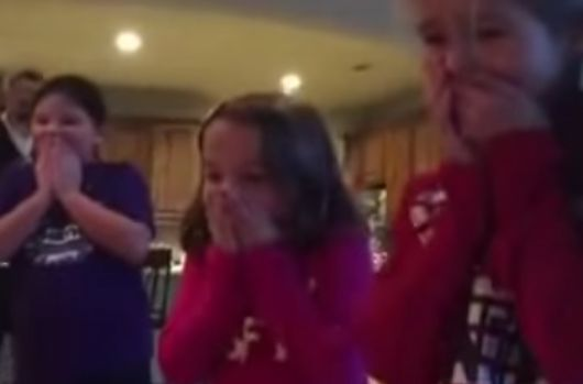 Parents Surprise Daughters With an Adopted Baby Brother Under the Christmas Tree