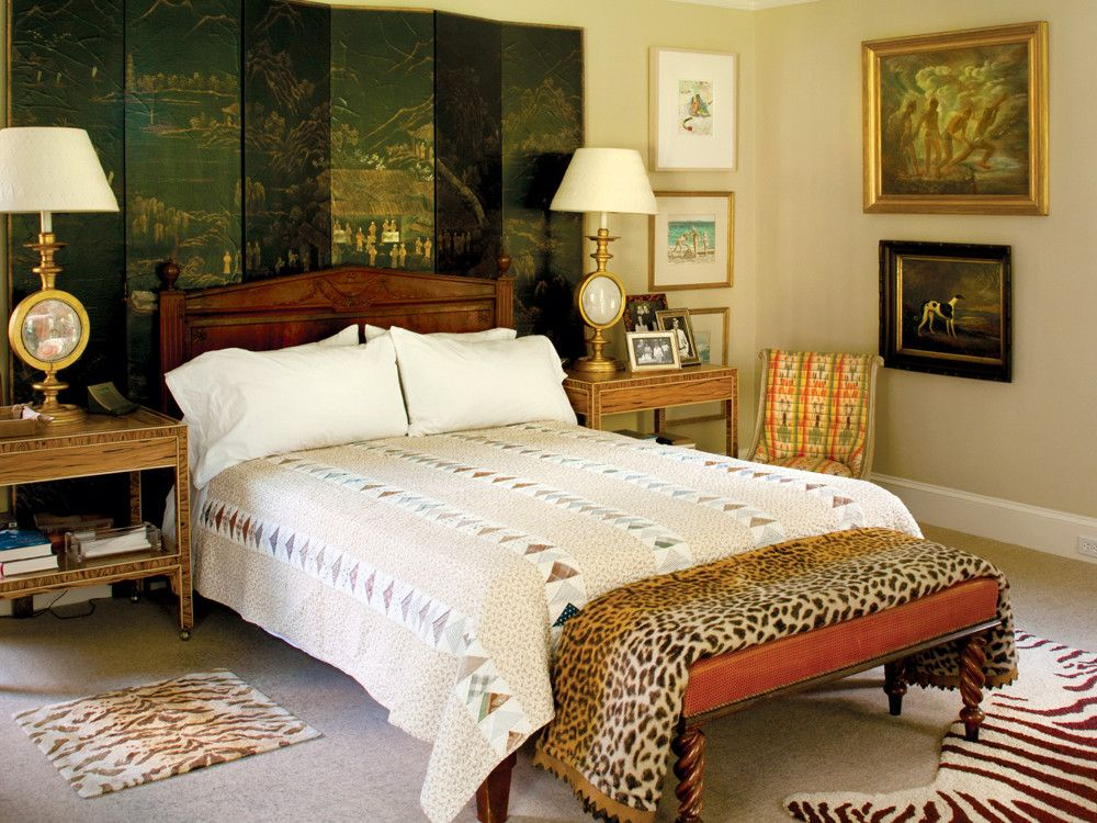 The couple brought the screen behind the bed from their New York apartment. The quilts are antique. The lamps on the bedside tables were a gift from Albert Hadley for their former Bridgehampton house.