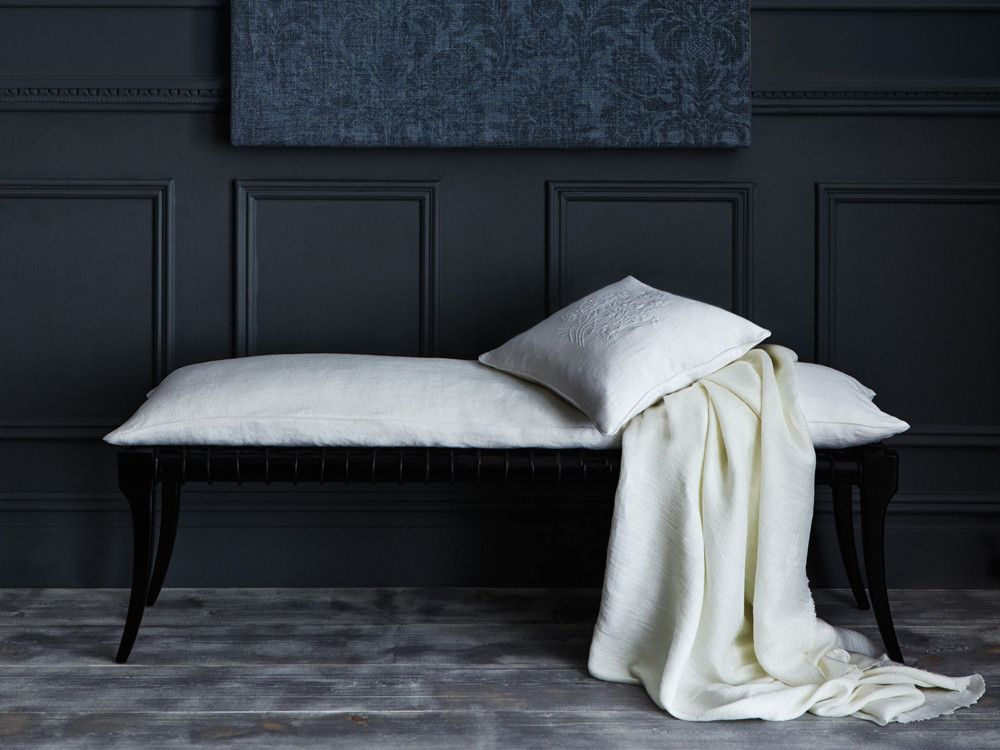 Bespoke bench upholstered in Casablanca Midnight with a Monet Morning Snow cushion and an Ormolu Feather throw.