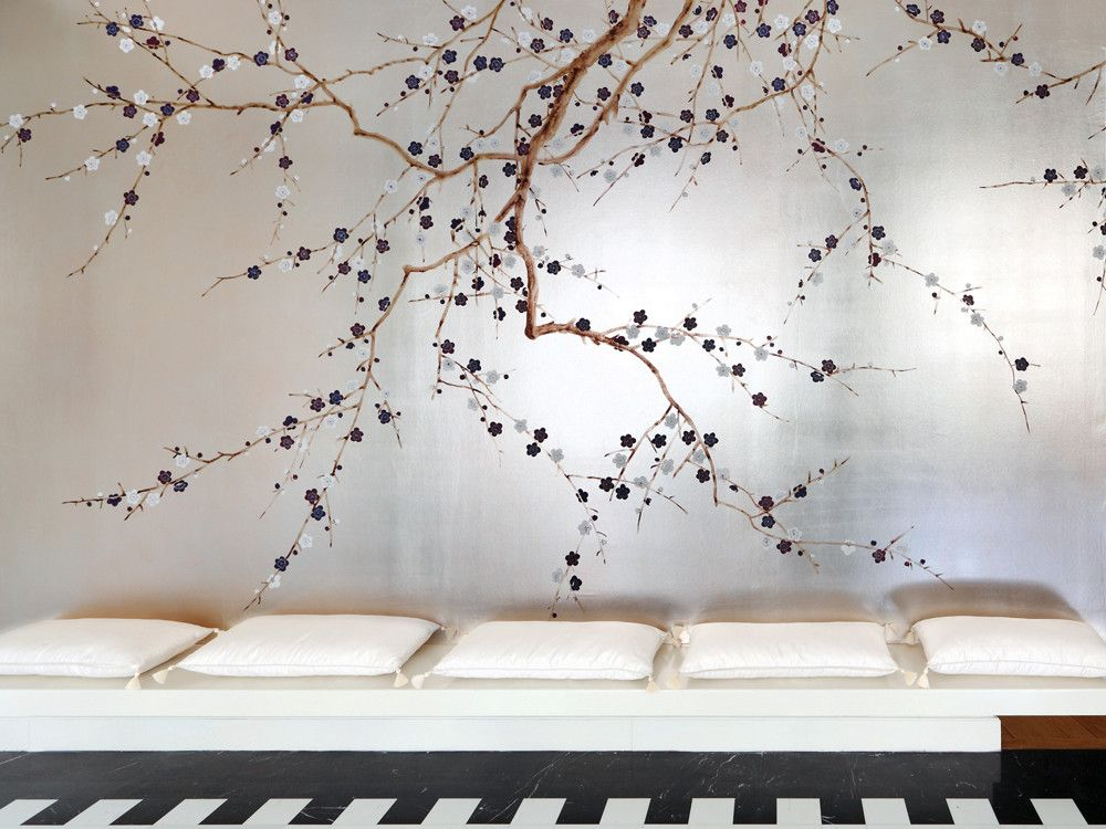 Serene and glamorous, this room is completely enveloped in the Japanese-inspired pattern called Plum Blossom, here in lavender on tarnished silver-gilded paper. (Photography: Marie-Caroline Lucat)
