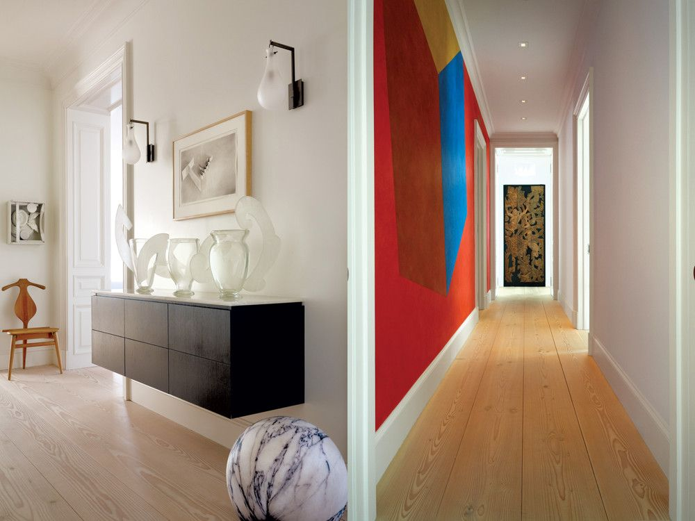 Left: In the entry hall, a custom ebonized console with 
