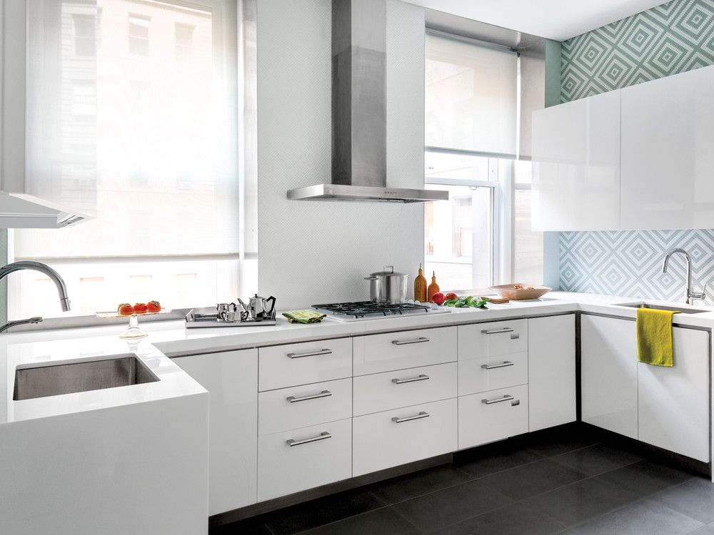 After completely gutting the kitchen, Elias lined the walls with white lacquer counters and cabinets to create as much functional space as possible.