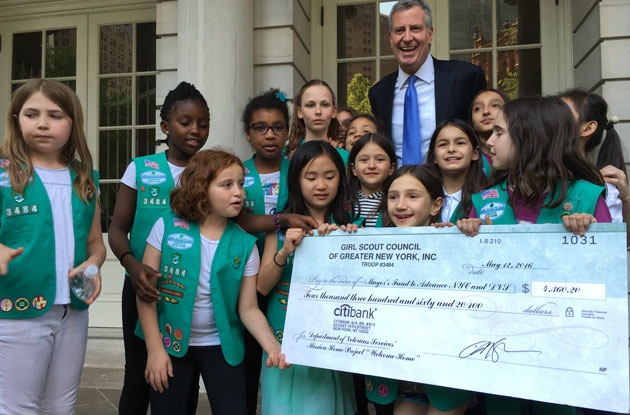 Local Girl Scouts Donate All of Their Cookie Sale Profit to City's Veterans