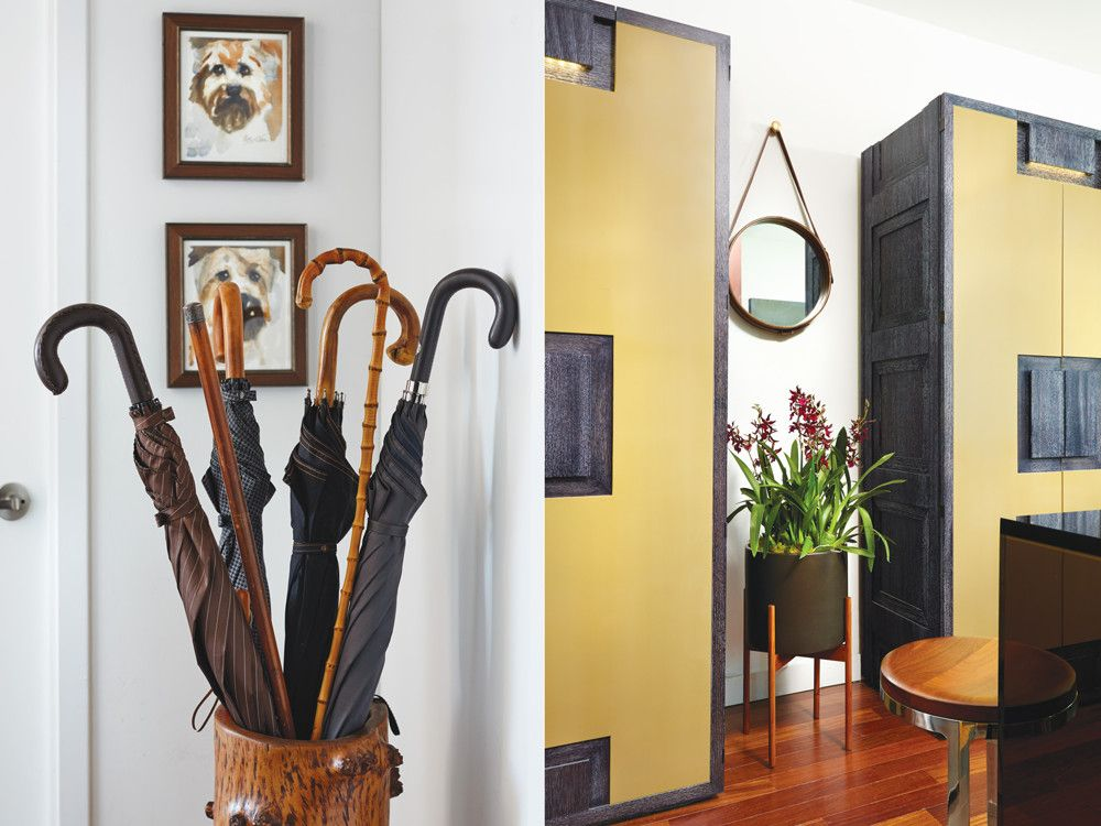 Left. A vintage umbrella stand awaits beneath watercolor dog portraits. Right. Cabinets are by Eason and fabricated by New Day Woodwork.