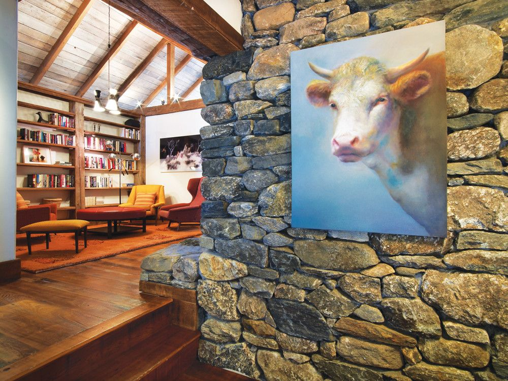 A modern portrait of a steer honors the barn's original function. The master suite's sitting room has comfortable 