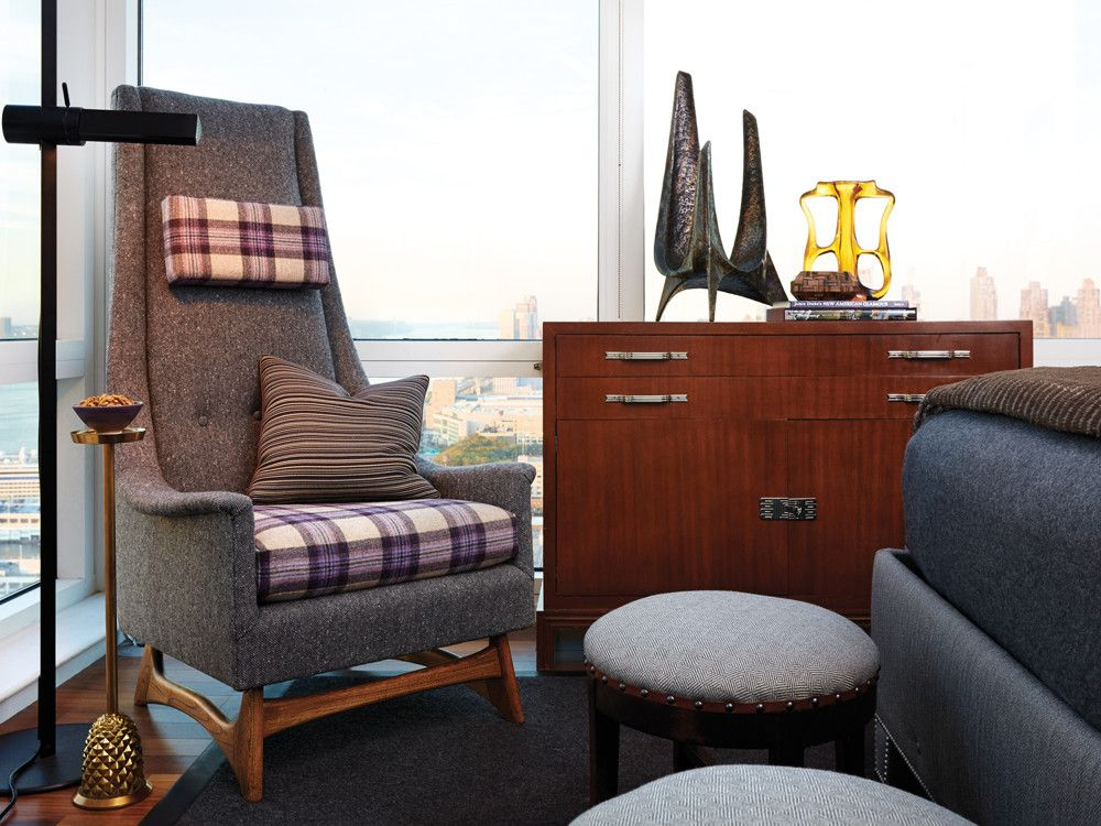 The armchair is by Adrian Pearsall, beside a 1970s Gianfranco Frattini floor lamp.