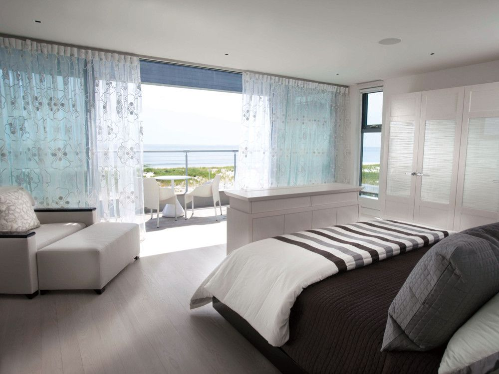 The serene master bedroom suite opens to a private terrace just for two.