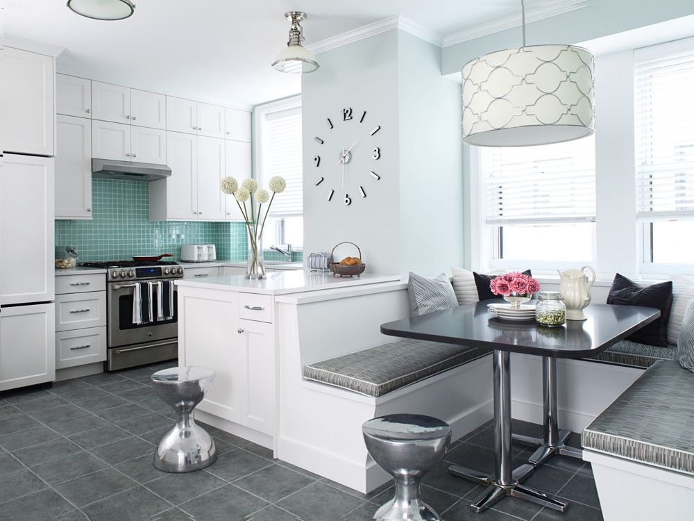 Polished chrome accents add highlights and sparkle to the soft palette: the stools, light fixtures, table base, and clock are all in conversation with one another creating connecting links.