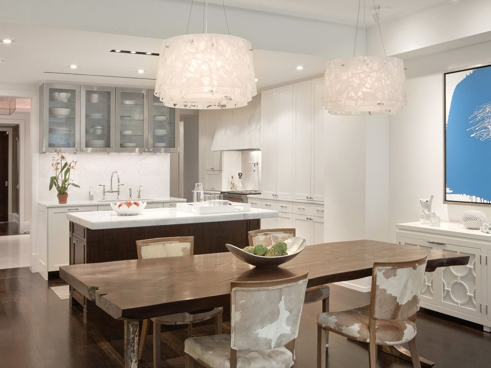 In the kitchen/dining room, light fixtures from Louis Poulsen play off  Art Deco chairs by Jules Leleu and Mind Float by Serena Bocchino.