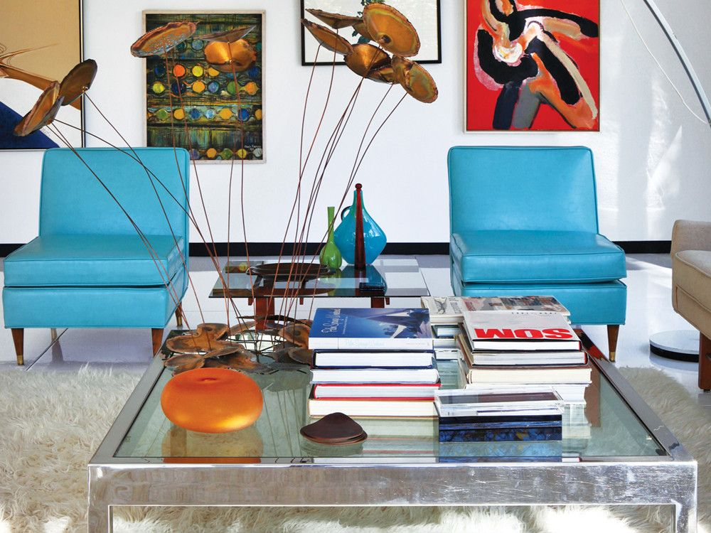 Two of-the-period aqua leather chairs overlook the Harry Bertoia sculpture on the coffee table.