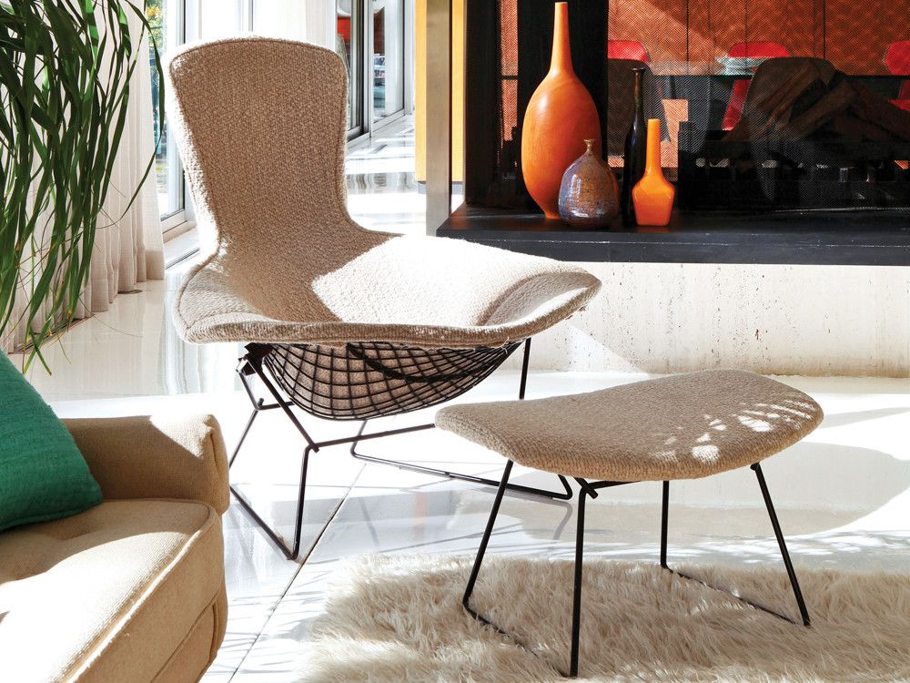 Completing the living room seating arrangement is an original Bertoia Bird chair with ottoman.