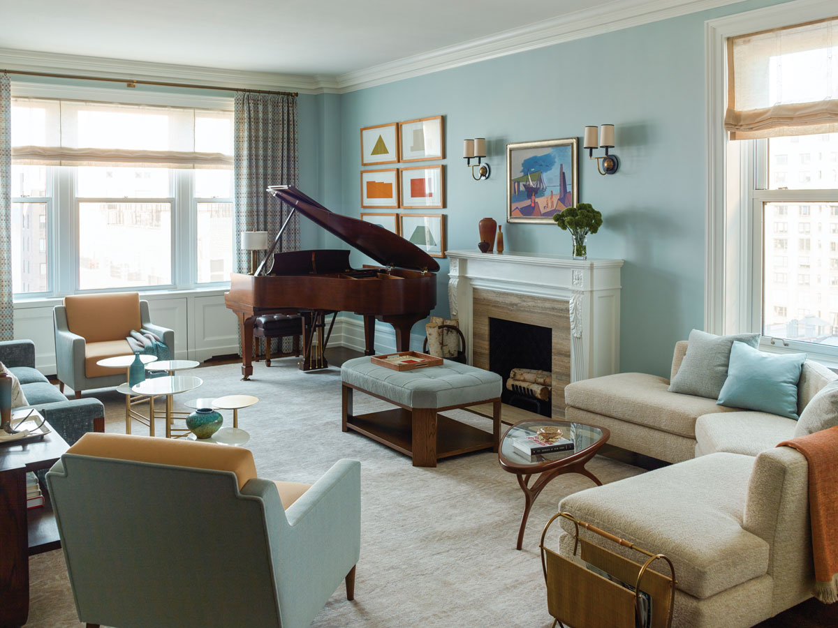 The husband finally got a dreamed-of piano. Prints by Robert Mangold line the wall behind it.