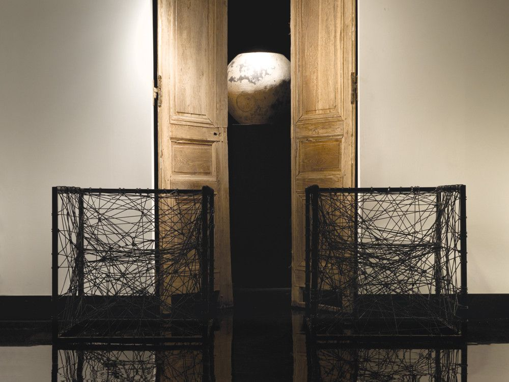 19th-century French wood doors supply the backdrop for 