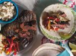 Weeknight Recipe: Pomegranate-Glazed Skirt Steak Fajitas with Roasted Peanut Slaw