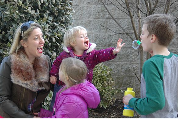 mom and kids blowing bubbles