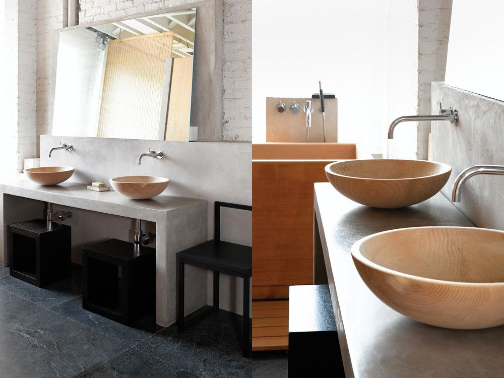 Left: For the master bathroom, Orban took inspiration from the Japanese aesthetic, installing side-by-side Hinoki wood basins and a soapstone floor. The faucets are by Vola, and the chair by Cappellini. Right: A close-up of the Hinoki wood basins; perpendicular to the basins is a Hinoki wood tub.