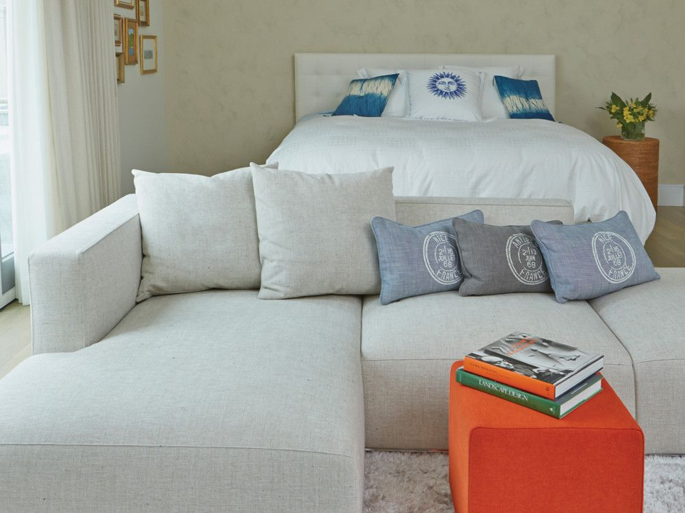 In the guest bedroom, walls in a glazed paint finish, a shag carpet from Ligne Roset, and a linen-covered 