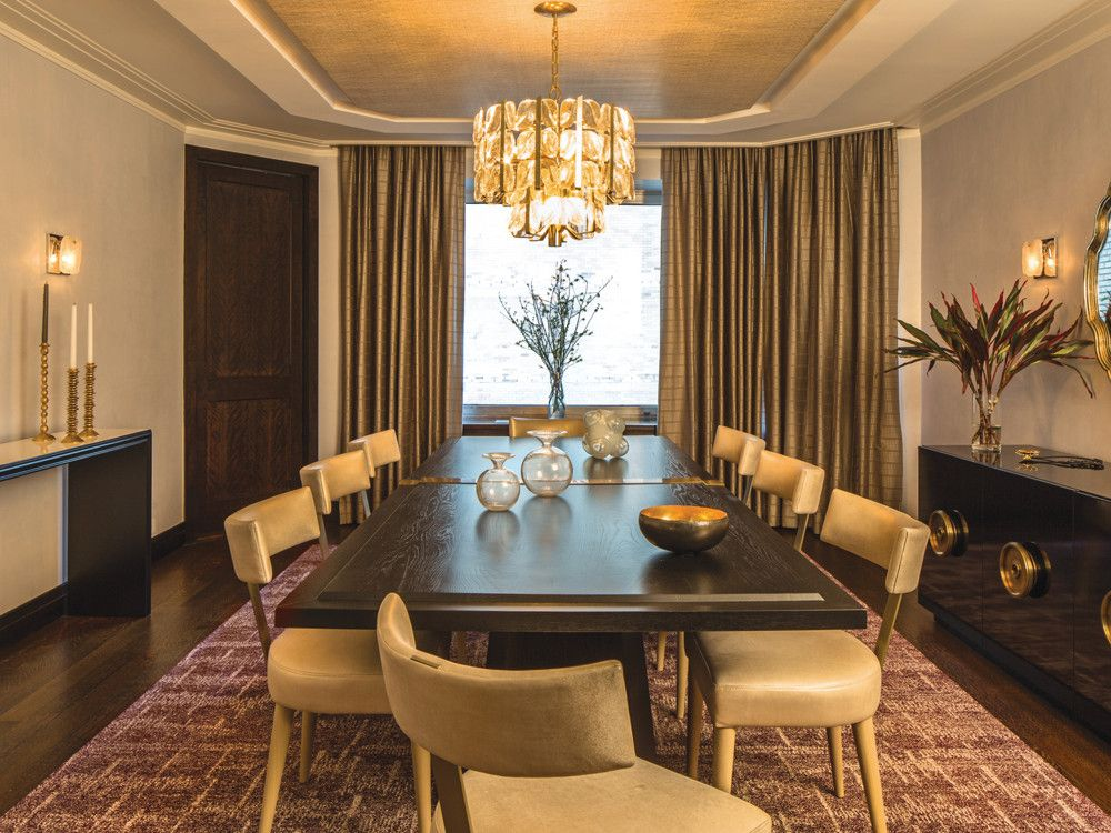 Story mitigated the lack of view with glamour, starting with an Austrian chandelier from Young Blood and 1950s Kalmar sconces from Thomas Hayes Gallery. Bronzy Claremont drapes and custom hardware by Darren Vigilant on the Draperesque lacquer buffet add more sparkle.