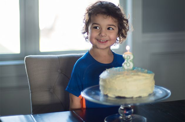 boy with birthday cake and three candle
