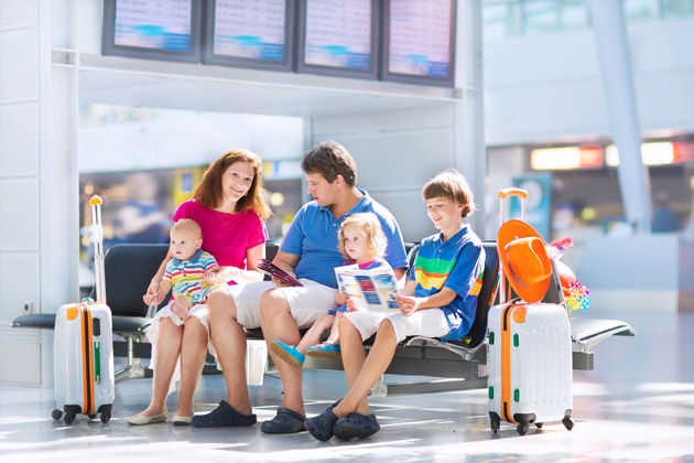 family traveling in airport