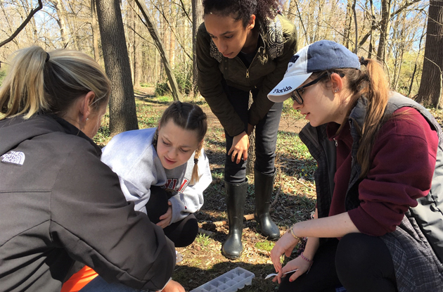 AHA Students Release Trout Raised in Classroom Into River