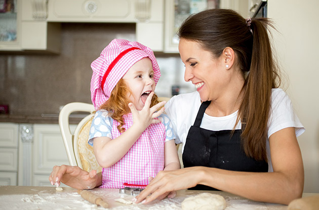 child baking with a babysitter