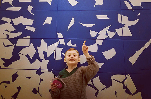 boy throwing papers
