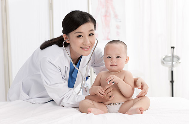 female pediatrician with baby