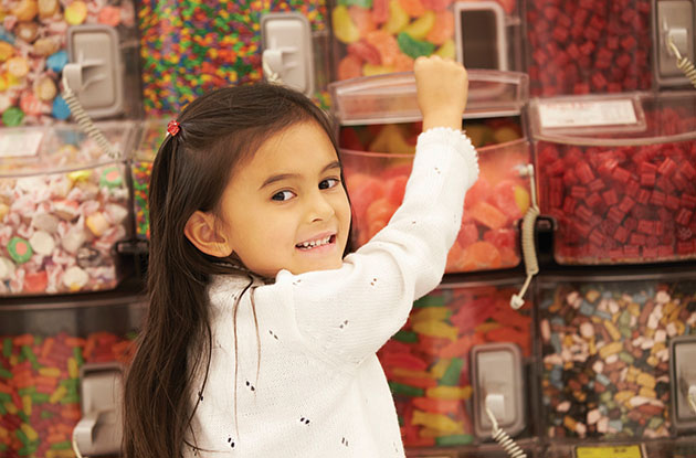girl choosing candy