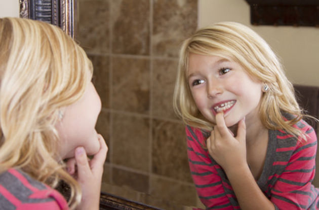 Adult Teeth Growing Behind Baby Teeth? Here's What to Do