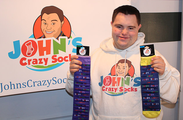 Young Man With Special Needs Celebrates Booming Sock Business