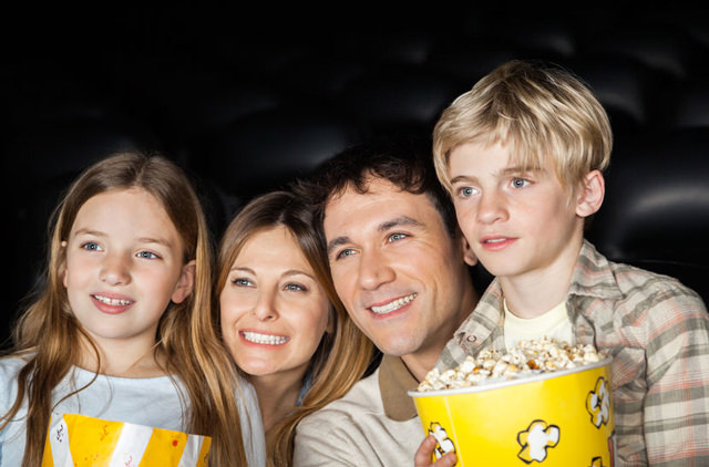 family at movie theater