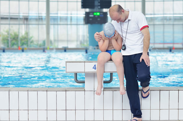 coach with swimmer