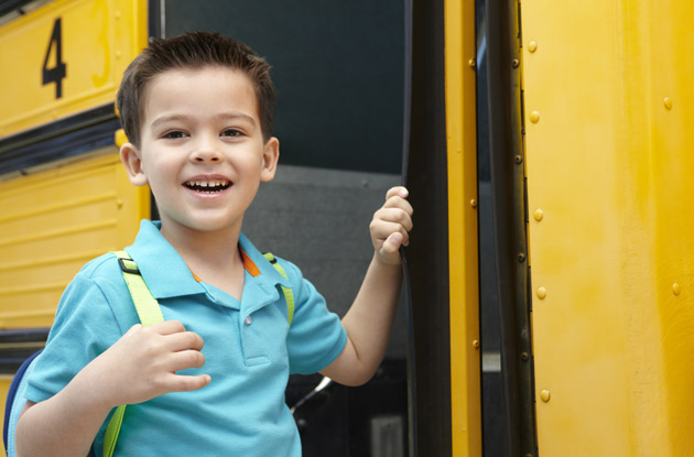 boy boarding a school bus