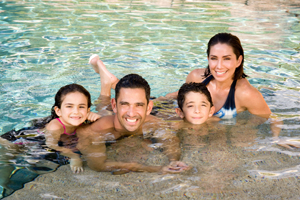 Jorge and Laura Posada with children