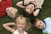 Youthfest at SUNY Rockland; kids lying in the grass