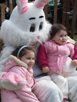 easter bunny with kids; kids sitting on easter bunny's lap