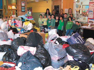 Students and staff at Tappan Zee Elementary School with some of the goods they collected for Haitian relief.