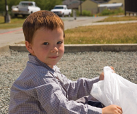 Pitch in for Parks; child cleaning up; child volunteer