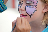 face painting; face painter; child getting face painted