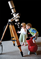children looking in telescope; children looking at stars; kids playing with telescope